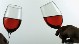 Slow Motion Cheers with Glasses of Red Wine