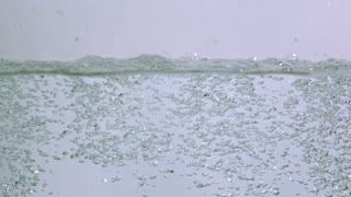 Slow Motion Clear Bubbles Rising to Surface