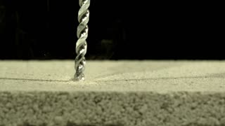 Slow Motion Drilling Into Concrete 1