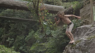 Slow motion extreme cliff diving in amazon jungle