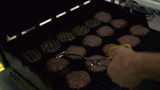Slow Motion Flipping Burgers on Grill