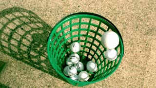 Slow Motion Golf Balls in Bucket