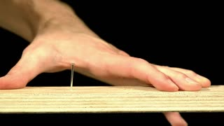 Slow Motion Hammering Nail Into Board