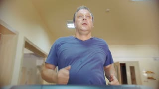 Slow motion of a man using treadmill in the gym. Regular physical activity is necessary for people of all ages