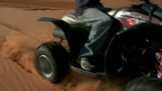 Slow Motion Of Atv Rider On Sand