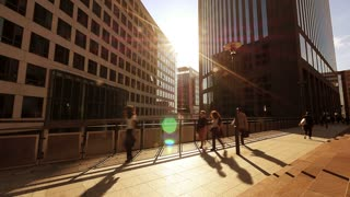 slow motion of business people walking down the street. modern buildings