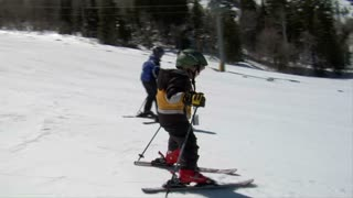Slow Motion On Little Kids Skiing Well Downhill