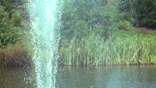 Slow Motion Pond Fountain Shooting Water