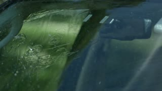 Slow Motion Rain Hitting Car Windshield