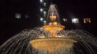 Slow motion shot of a beautiful fountain at night