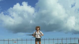 Slow motion shot of a happy traveler girl enjoy under landing plane