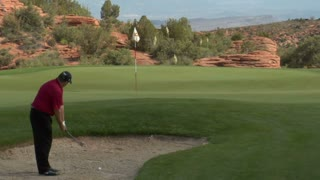 Slow-motion Shot Of Golfer Chipping Out Of Sand Trap Onto Green