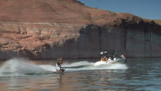 Slow-motion Speedboat Pulls Wake Boarder Lake Powell Utah  Shot