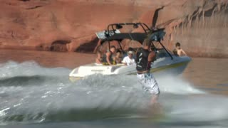 Slow-motion Speedboat Pulls Wake Boarder Lake Powell Utah Zoom Shot