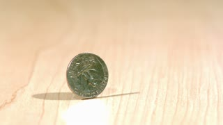 Slow Motion Spinning Quarter 3