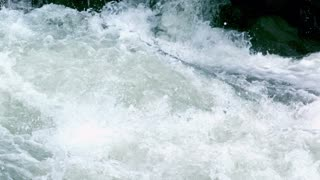 Slow Motion Splashing River Rapids Closeup