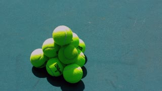 Slow Motion Tennis Ball Pile Collapsing