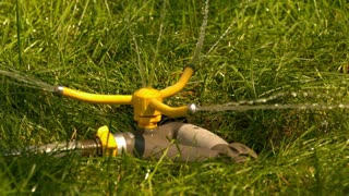 Slow Motion Three Way Sprinkler Spinning Closeup