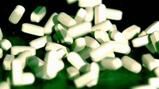Slow Motion White Pills Falling Closeup