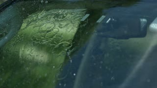 Slow Motion Windshield Wiper Closeup 2