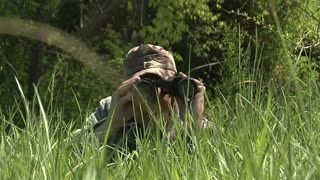 Slow Motion World War 2 German Soldier Looking Through Binoculars And Picking Up Rifle