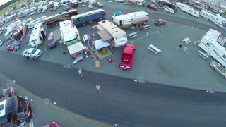 slow moving aerial shot over rv trailers in parking lot