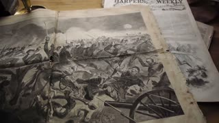 slow pan left over newspaper spread depicting Civil War battle