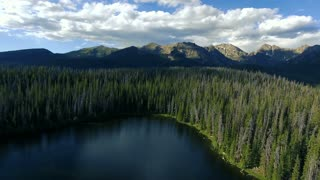 Slow smooth aerial drone flight over a lake in the Rocky Mountains of Colorado