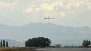 Smal Plane Landing on Runway