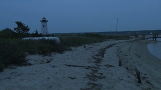 Small Beach Lighthouse Blinking Red at Dusk