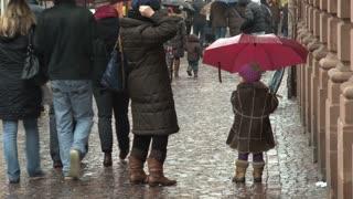 Small Child With Umbrella