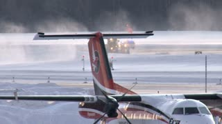 Small Planes On Snowy Runway