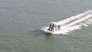 Small Police Boat Cruising Through Water