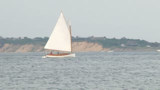 Small Sailboat Drifts By on Calm Water 1