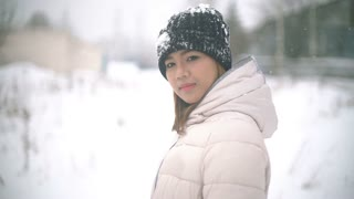 Smiling Asian woman winter portrait slowmotion