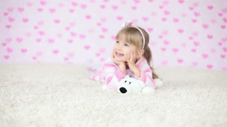Smiling baby lying on the carpet