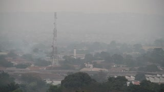 Smoky Haze In Kinshasa With Radio Tower
