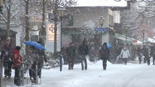 Snow Covered Street With People