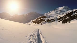 snow landscape. winter mountains. hikers paths aerial view. fly over