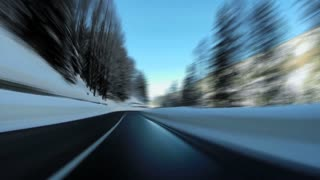 snow road. car driving street. winter landscape. speeding