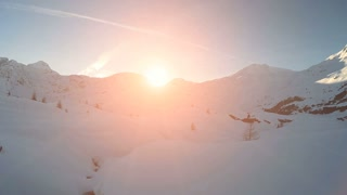 snow winter landscape. mountains nature. sunset. aerial view. fly over. tourism