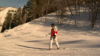 Snowboarder Glides Downhill On Sunny Day