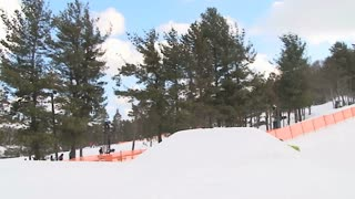 Snowboarder wipes out off jump