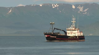 Snowcapped Mountains Behind Crabbing Ship