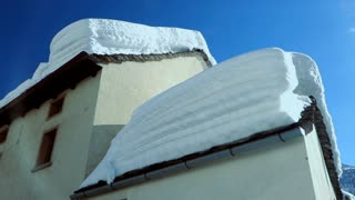 snowcapped roofs. houses covered with snow. winter season