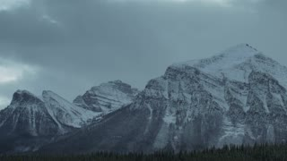 Snowy Mountains beyond forest timelapse