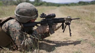 Soldier firing a rifle