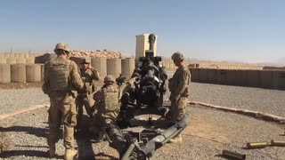 Soldiers Fire M119 Howitzer canon