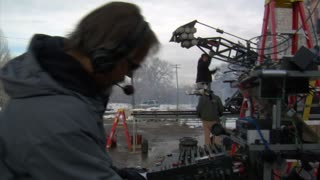 Soundman Adjusts Sound Levels On Film Set