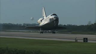 Space Shuttle Landing on Runway with Parachute Out